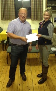 W.Bro Alan Clark presenting the £500 to Mrs Charlotte Swift (Treasurer of Sheldon Parish Meeting)